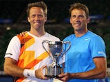 Lukasz Kubot and Robert Lindstedt celebrate with the trophy after winning the men's doubles final against Eric Butorac and Raven Klaasen on January 25, 2014