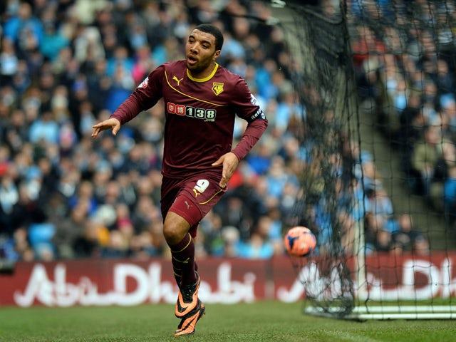 Watford's English forward Troy Deeney celebrates scoring a goal during the English FA Cup fourth round football match between Manchester City and Watford at the Etihad Stadium in Manchester on January 25, 2014