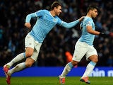 Manchester City's Argentinian striker Sergio Aguero celebrates scoring his second goal during the English FA Cup fourth round football match between Manchester City and Watford at the Etihad Stadium in Manchester on January 25, 2014