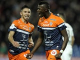 Montpellier's French forward Mbaye Niang (R) reacts after scoring a goal during the French L1 football match Montpellier vs Nice at Mosson stadium in Montpellier, southern France, on January 25, 2014