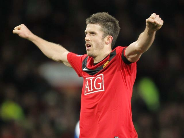 Michael Carrick celebrates scoring against Wigan Athletic on December 30, 2009.