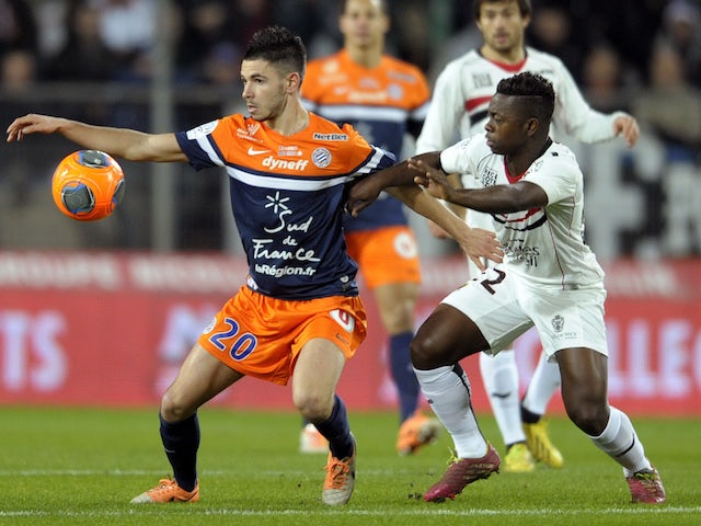 Montpellier's French mifielder Morgan Sanson (L) vies for the ball with Nice's French midfielder Nampalys Mendy during the French L1 football match on January 25, 2014