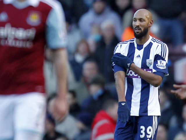 Nicolas Anelka celebrates scoring West Bromwich Albion's second goal with a 'quenelle' gesture on December 28, 2013