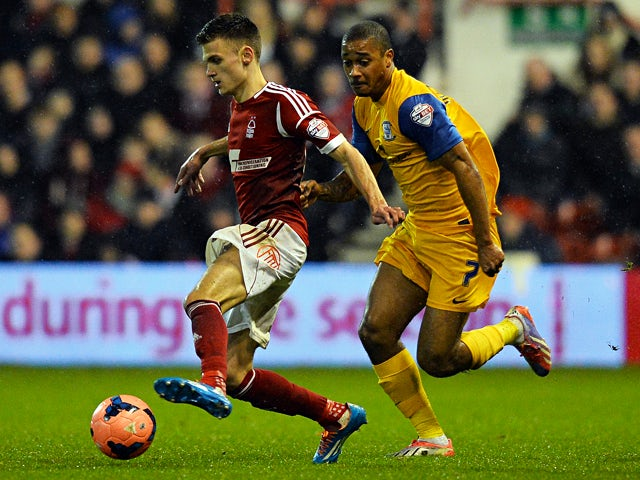 Nottingham Forest's English forward Jamie Paterson and Preston North End's Jamaican midfielder Chris Humphrey compete for the ball during the English FA Cup fourth round match between Nottingham Forest and Preston North End at City Ground in Nottingham on