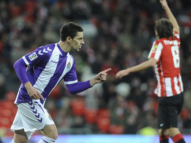 Valladolid's Oscar Gonzalez celebrates after scoring the opening goal against Athletic Bilbao during their La Liga match on January 20, 2014