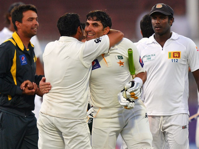 Pakistan cricket team captain Misbah-ul-Haq celebrate with teammates after winning the final day of the third and final cricket Test match against Sri Lanka at the Sharjah International Cricket Stadium, in the Gulf emirate of Shrajah on January 20, 2014