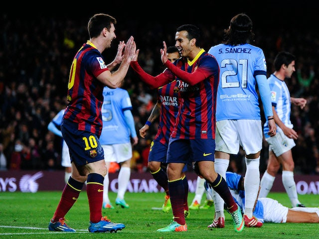 Pedro Rodriguez of FC Barcelona celebrates with his team mate Lionel Messi after scoring his team's second goal during the La Liga match against Malaga on January 26, 2014