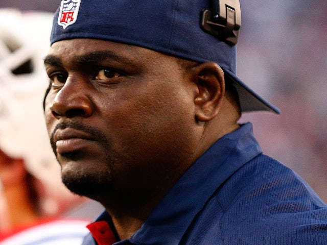 Pepper Johnson, coach of the New England Patriots, watches the action against the New York Jets at Gillette Stadium on October 21, 2012