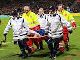 Monaco's Columbian forward Radamel Falcao (C) is lifted away from the pitch after being injured during the French Cup football match between Chasselay (MDA) and Monaco (ASM) on January 22, 2014