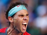 Rafael Nadal roars in celebration during the Australian Open quarter-final against Grigor Dimitrov in Melbourne on January 22, 2014