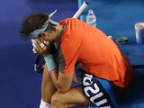 Rafael Nadal puts his head in his hands during the Australian Open final in Melbourne on January 26, 2014