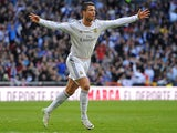 Cristiano Ronaldo of Real Madrid CF celebrates after scoring the opening goal during the La Liga match between Real Madrid CF and Granada CF at Santiago Bernabeu stadium on January 25, 2014