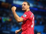 Rio Ferdinand celebrates with the Manchester United supporters at the Etihad Stadium on December 09, 2012.