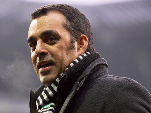 Bremen's head coach Robin Dutt stands on the pitch during a warm-up session prior to the German first division Bundesliga football match Werder Bremen vs Bayern Munich on December 7, 2013