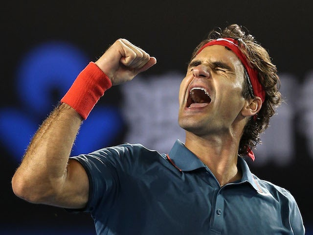 Roger Federer celebrates during the Australian Open quarter-final against Andy Murray in Melbourne on January 22, 2014