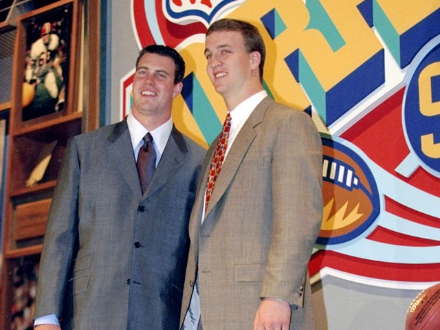 Second overall pick Ryan Leaf poses alongside first overall pick Peyton Manning during the first round of the 1998