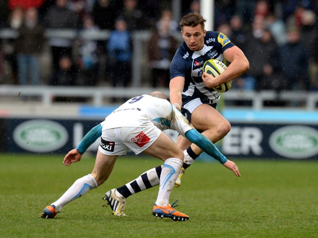 Charlie Ingall of Sale Sharks is tackled by Paul Hodgson of Worcester Warriors during the LV= Cup match between Sale Sharks and Worcester Warriors at AJ Bell Stadium on January 25, 2014