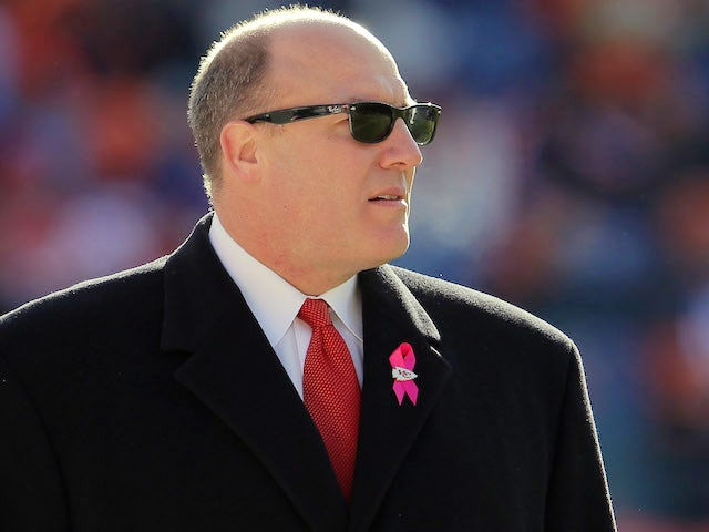 Kansas City Chiefs General Manager Scott Pioli looks on from the sidelines as the Chiefs prepare to face the Denver Broncos at Sports Authority Field at Mile High on January 1, 2012