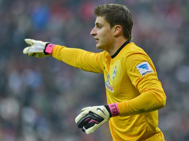 Bremen's German keeper Sebastian Mielitz in action during the German first division Bundesliga football match FC Bayern Munich vs SV Werder Bremen in the southern German city of Munich on February 23, 2013