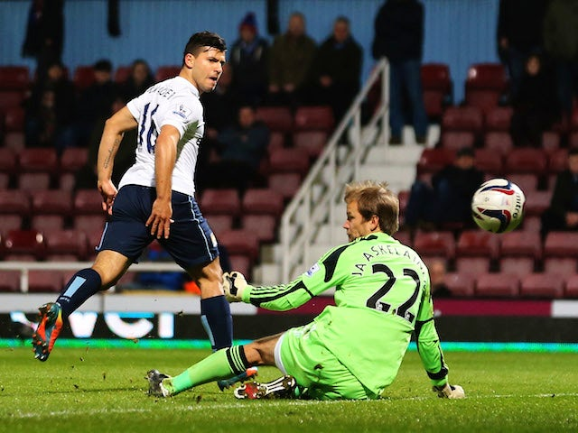 Sergio Aguero of Manchester City beats Jussi Jaaskelainen of West Ham United to score their second goal during the Capital One Cup Semi-Final, Second Leg match on January 21, 2014