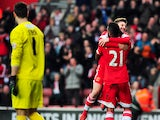 Southampton's Brazilian midfielder Guly Do Prado celebrates scoring a penalty with English midfielder Adam Lallana during the English FA Cup fourth round football match between Southampton and Yeovil Town at St Mary's Stadium in Southampton on January 25,
