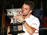 Stanislas Wawrinka of Switzerland kisses the Norman Brookes Challenge Cup after winning the Australian Open on January 26, 2014