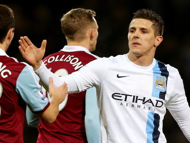 Steven Jovetic of Manchester City (R) dhakes hands with Stewart Downing of West Ham United (L) after the Capital One Cup Semi-Final, Second Leg match on January 21, 2014