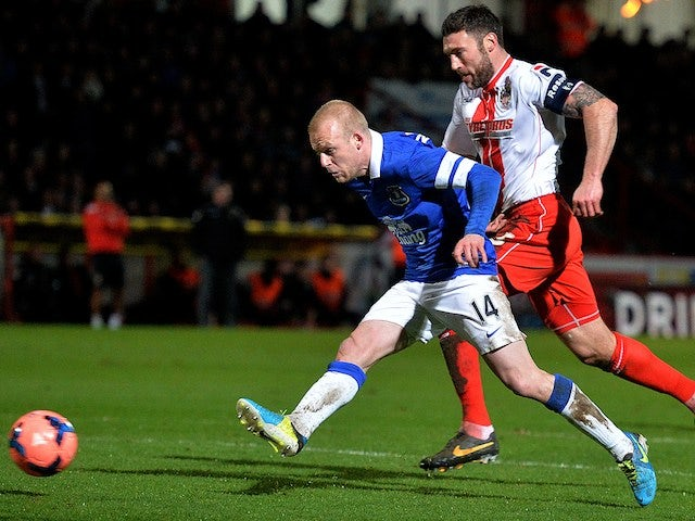 Everton's Scottish striker Steven Naismith (L) scores his second goal during the English FA Cup fourth round football match against Stevenage on January 25, 2014