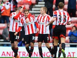 Charis Mavrias of Sunderland celebrates with team mates after scoring during the FA Cup Fourth Round match between Sunderland and Kidderminster Harriers at the Stadium of Light on January 25, 2014