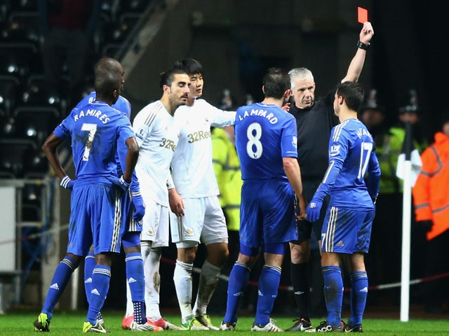Eden Hazard of Chelsea is sent off by referee Chris Foy after kicking a ball boy during the Capital One Cup Semi-Final Second Leg match between Swansea City and Chelsea at Liberty Stadium on January 23, 2013