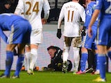 A ballboy lies on the grounf and reacts after a altercation with Chelsea's Belgium midfielder Eden Hazard during the English League Cup semi-final second leg football match between Swansea City and Chelsea at The Liberty stadium in Cardiff, south Wales on
