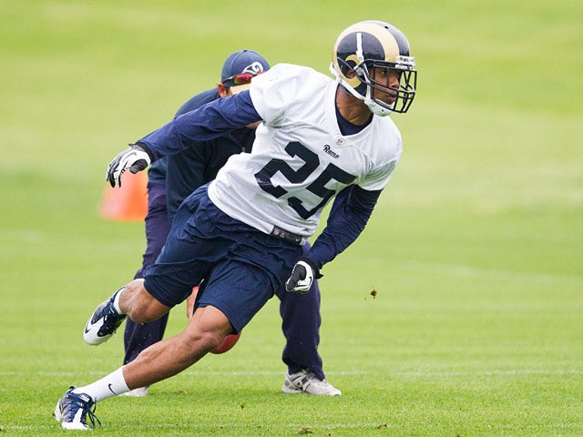 T.J. McDonald (25) of the St. Louis Rams runs for a drill during rookie camp on May 10, 2013