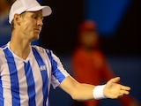 Tomas Berdych of the Czech Republic reacts to point to Stanislas Wawrinka of Switzerland during their men's singles semi-final match on day 11 of the 2014 Australian Open tennis tournament on January 23, 2014