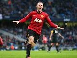 Wayne Rooney celebrates scoring against Manchester City on December 09, 2012.