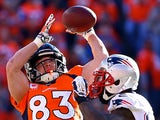 Wes Welker #83 of the Denver Broncos catches a second quarter pass over Kyle Arrington #25 of the New England Patriots during the AFC Championship game on January 19, 2014