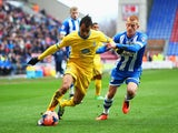 Marouane Chamakh of Crystal Palace is closed down by Ben Watson of Wigan Athletic during the Budweiser FA Cup fourth round match between Wigan Athletic and Crystal Palace at DW Stadium on January 25, 2014