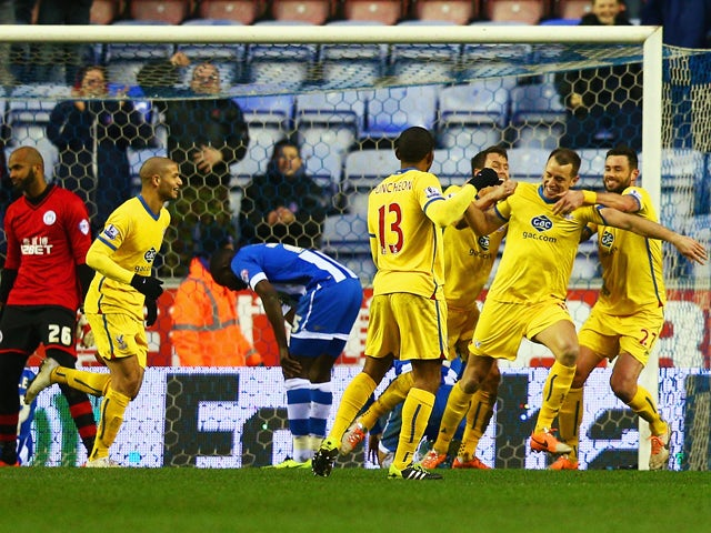 Aaron Wilbraham of Crystal Palace celebrates his goal with team mates during the Budweiser FA Cup fourth round match between Wigan Athletic and Crystal Palace at DW Stadium on January 25, 2014