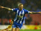 James McClean of Wigan Athletic celebrates his goal during the Budweiser FA Cup fourth round match between Wigan Athletic and Crystal Palace at DW Stadium on January 25, 2014