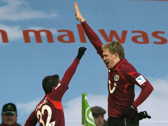 Hannover's Artjoms Rudnevs celebrates with Hanover's midfielder Leonardo Bittencourt after scoring the first goal during the German first division Bundesliga football match Wolfsburg vs Hanover 96 in Wolfsburg on January 25, 2014