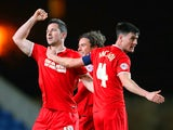 Yann Kermorgant of Charlton celebrates scoring their third goal with team mates during the FA Cup Third Round Replay match against Oxford United on January 21, 2014