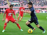 Yuto Nagatomo of FC Inter Milan (R) and Gino Peruzzi of Calcio Catania compete for the ball during the Serie A match between FC Internazionale Milano and Calcio Catania on January 26, 2014