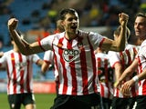 Aaron Martin of Southampton celebrates with team-mates after scoring his side's second goal during the FA Cup 3rd round match between Coventry City and Southampton at the Ricoh Arena on January 07, 2012