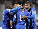 Bastia's Mauritanian midfielder Adama Ba is congratulated by teammates after scoring a goal during the French L1 football match against Guingamp on February 1, 2014