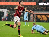 AC Milan's French defender Adil Rami celebrates after scoring a goal during the Serie A football match against Torino on February 1, 2014