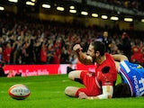 Wales wing Alex Cuthbert celebrates the opening try during the RBS Six Nations match between Wales and Italy at the Millennium stadium on February 1, 2014