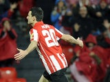 Athletic Club Bilbao's Aritz Aduriz celebrates after scoring the opening goal against Atletico Madrid during their Copa del Rey match on January 29, 2014