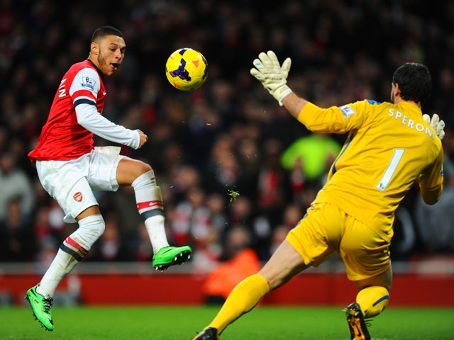 Alex Oxlade-Chamberlain of Arsenal scores the first goal past Julian Speroni of Crystal Palace during the Barclays Premier League match between Arsenal and Crystal Palace at Emirates Stadium on February 2, 2014