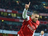 Arsenal's English midfielder Alex Oxlade-Chamberlain celebrates after scoring a goal during the English Premier League football match between Arsenal and Crystal Palace at the Emirates Stadium in London on February 2, 2014