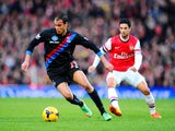 Marouane Chamakh of Crystal Palace is marshalled by Mikel Arteta of Arsenal during the Barclays Premier League match between Arsenal and Crystal Palace at Emirates Stadium on February 2, 2014