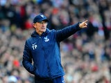 Tony Pulis manager of Crystal Palace gives instructions during the Barclays Premier League match between Arsenal and Crystal Palace at Emirates Stadium on February 2, 2014